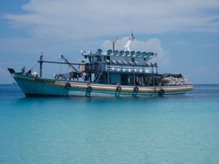 Fishing Boat Anchored on the Reef